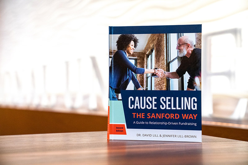 Cause Selling book displayed on a table
